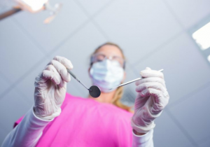 Dentist holding dental tools - Dental Anesthesia Alameda, CA
